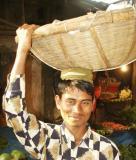 Young man carrying basket on his head, Bangladesh