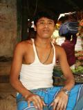 Young man in t-shirt, produce market, Dhaka