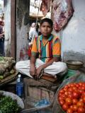 Boy working at produce stand, Dhaka