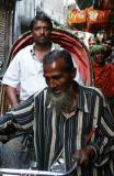 Rickshaw wallah with customer, Dhaka