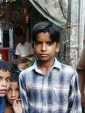Serious boy with 2 young children, Dhaka, Bangladesh