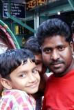 Smiling boy and man, Dhaka, Bangladesh
