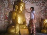 Applying gold leaf to the Buddha.