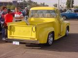 yellow Ford pickup truck