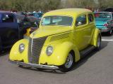 yellow 2 door sedan