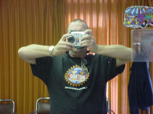 Jeffrey Lewis taking<br> a photo of self