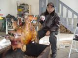 Dr. Louie Magtibay roasting the front part of the pig.