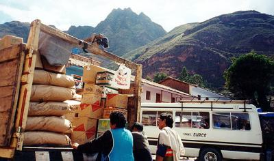 Pisac Market: unloading with gorgeous hill formations behind