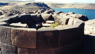 Sillustani - top of smaller tomb, with lake behind