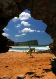 Avalon headland from cave with surfer