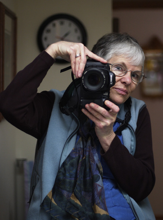 <B>Photographer at Work</B><BR>*<FONT size=2>Ann Chaikin</FONT>
