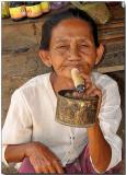 Smoking a cheroot - Phwassaw village , Bagan
