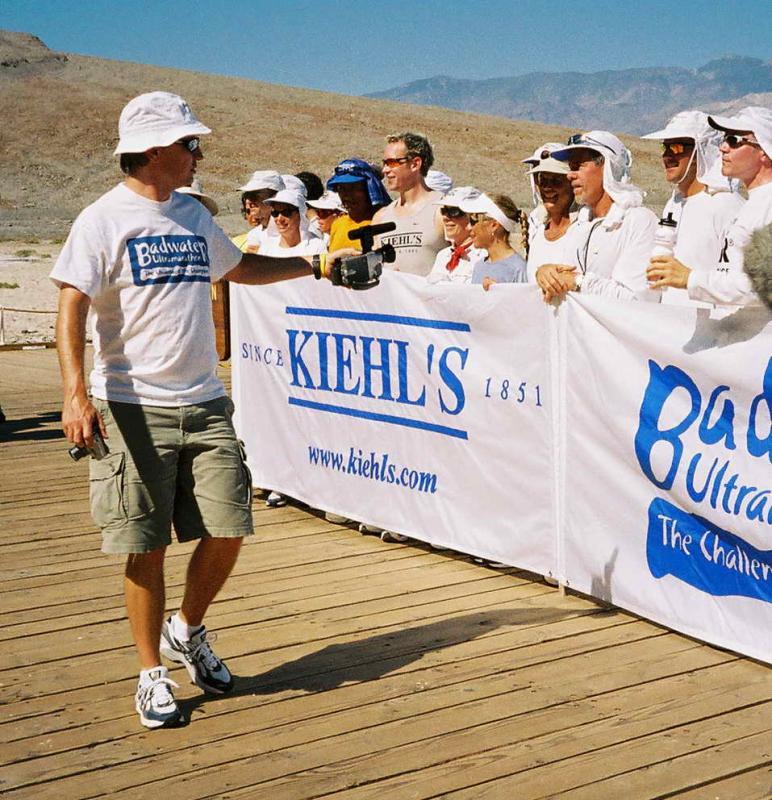 Chris Kostman, RD videotapes the runners