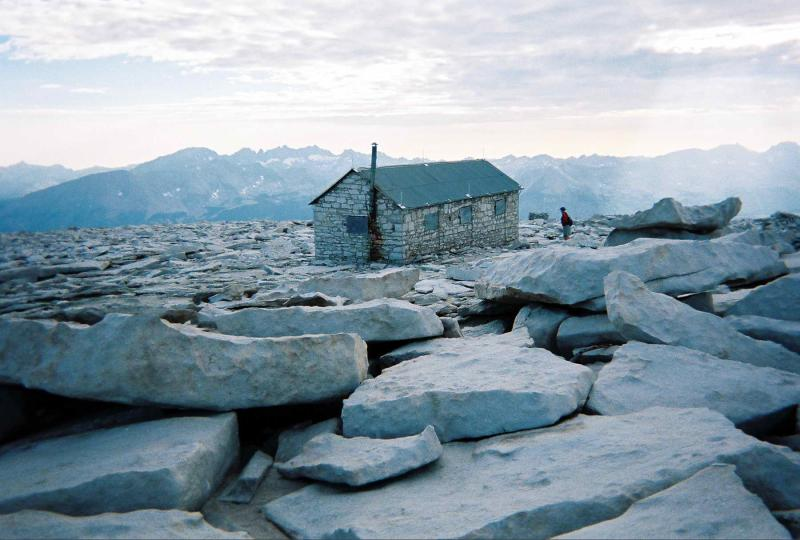 Survival hut on the summit holds the names of those who have been here. The chimney stands over 14,500 feet high