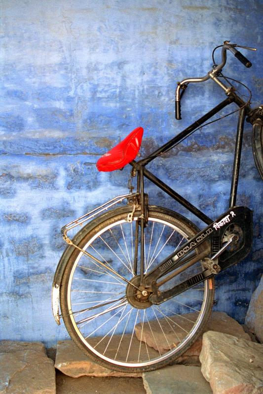 bicycle against blue wall.jpg