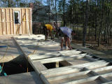 Carpenters build the front wall