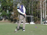 Greg demonstrates proper form....... but dirt flies with the ball
