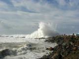 A giant wave dwarfs observers