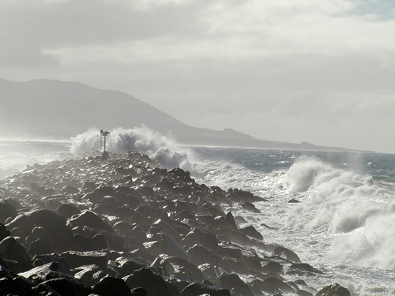 The breakwater pounded and wet