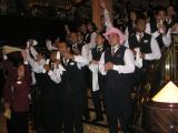Waiters singing for the guests