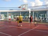 Playing basketball on the sports deck
