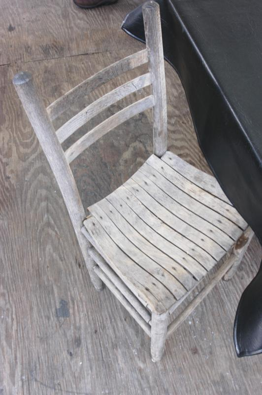 One of the old chairs; the ones that had nails that stuck out and ripped your pants.