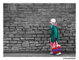 colourful old lady - background BW