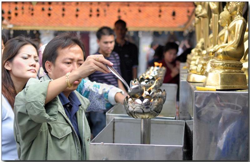 Burning oil as an act of worship to Buddha