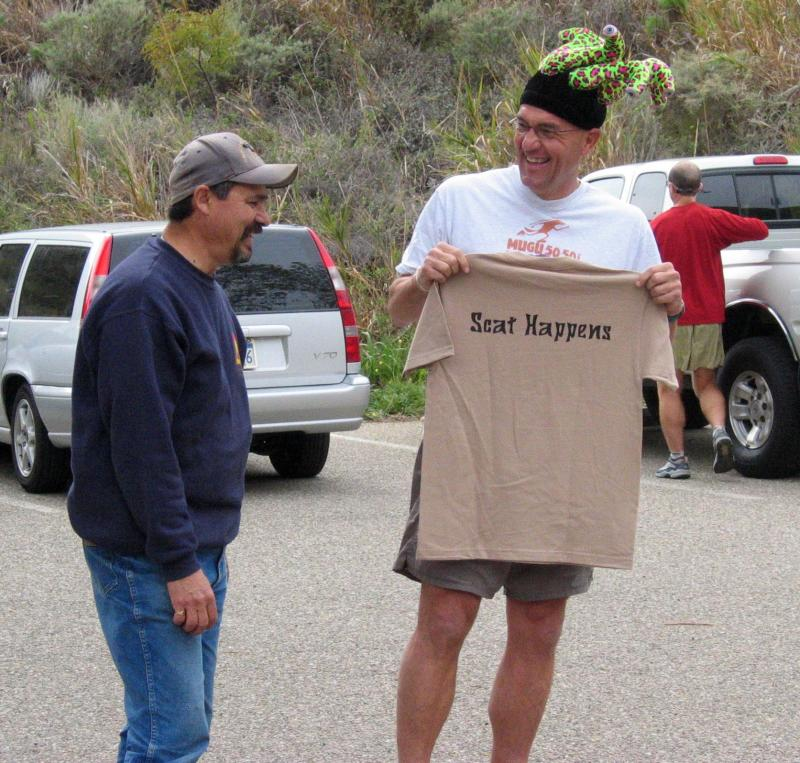 Chris Scott gives Frank Padilla a t-shirt