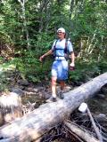 Tony crosses the log