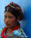 woman and blue wall, zunil, guatemala