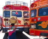 buses with woman, antigua, guatemala