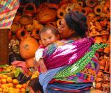 woman in front of pots, antigua market, guatemala