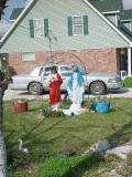 THE FOLKS IN CAJUN COUNTRY LOVE THEIR STATUES OF VIRGIN MARY AND THE SACRED HEART IN THE FRONT YARD AND NO BATH TUBS USED