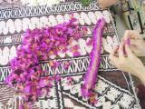 Sewing a Mauna Loa Vanda Lei