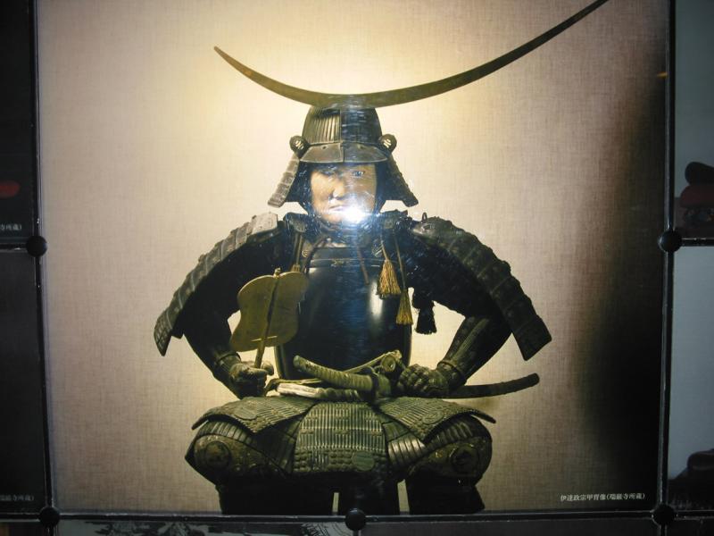 Masumune seated in Samurai Armor