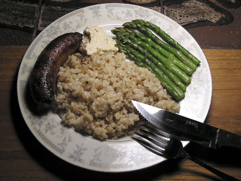 typical dinner at home - turkey sausage, photographer-made hummus bi tahini, asparagus, brown rice