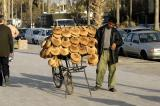 Vendor on the Corniche selling Kaak, eaten with a sweet cheesy pastery called kunafeh