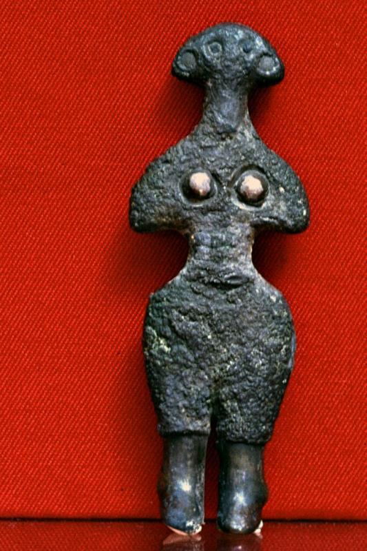 Stylized female statuette