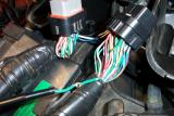 The first thing you do is cut and splice one ground wire to connect the coil (choke)