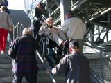 Dick Grimm goes up the stairwell. Loyd Anna and Bill Dehlinger gives Dick advice. Don Russell follows.