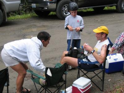 Sarah crews Wendell while son Aaron looks on