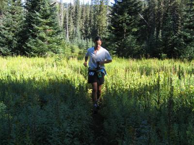 Tony C running through a meadow
