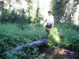 Tony C crosses a creek