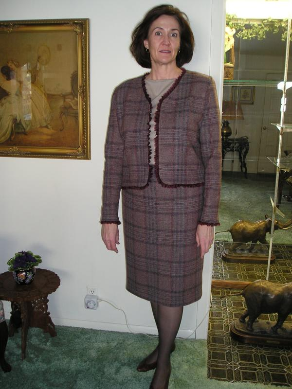 Mauve plaid wool suit w/silk organza ruffle.