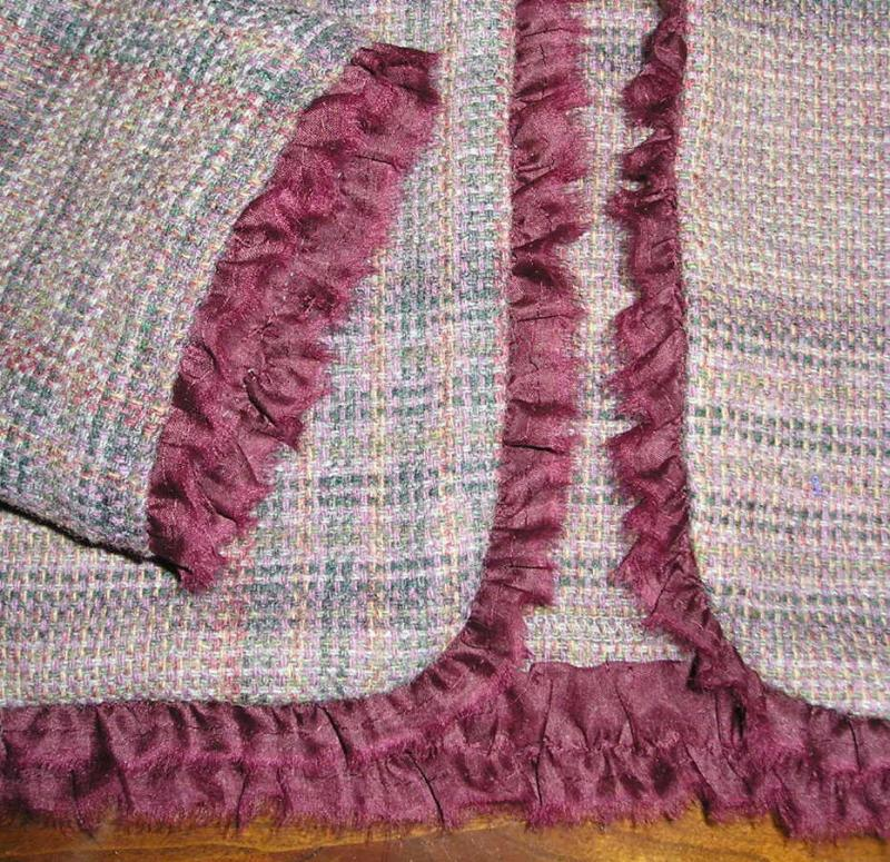 Close up of mauve plaid with ruffle.