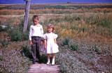 Chris and Lorraine going to Church; Diana, Sask., 1964