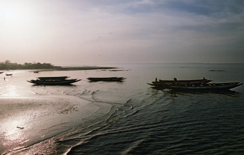 boats on sea at sunrise