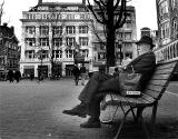 Sitting on a bench, looking at the past