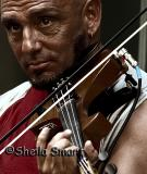 Close up of busker with violin